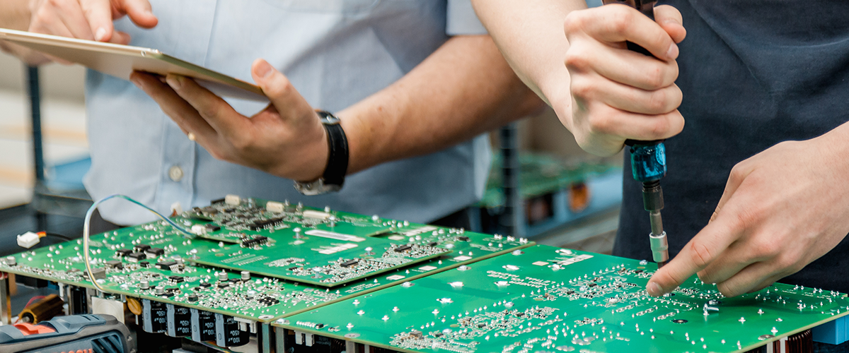 Employee working on circuitboard